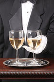 Waiter With Two Glasses of Chardonnay — Stock Photo