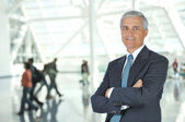 Blurred Travelers in Airport Concourse — Stock Photo