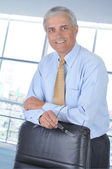 Businessman leaning of his chair — Stock Photo