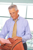 Businessman with File Box — Stock Photo