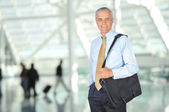 Smiling Businessman With Travel Bag — Stock Photo