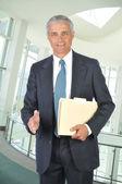 Businessman with file folder — Stock Photo