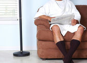 Man in Robe Reading Newspaper — Stock Photo