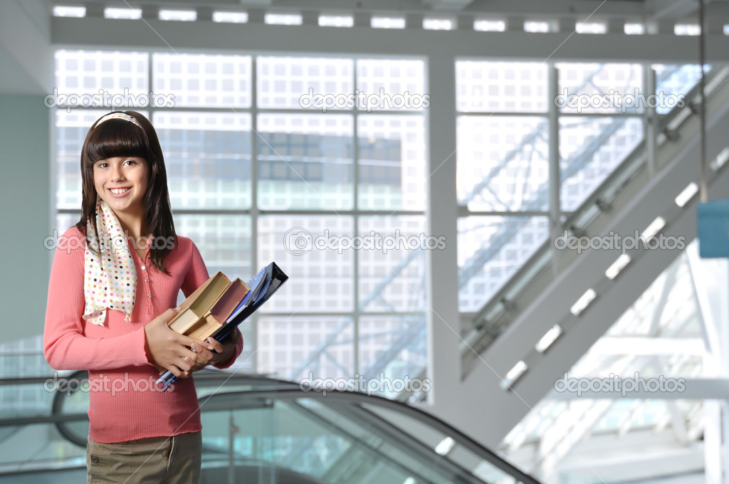 Teenage Female Student With Books in Modern School Building   Stock Photo #2080391