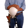 Carpenter holding level & hardhat — Stock Photo