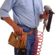Carpenter holding Nailgun — Stock Photo