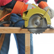 Construction Worker With Circular Saw — Stockfoto