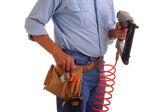 Carpenter holding Nailgun — Stock Photo