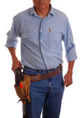 Carpenter in toolbelt holding drill — Stock Photo
