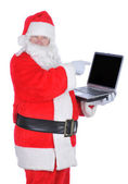 Santa Claus Pointing at Laptop — Stock Photo