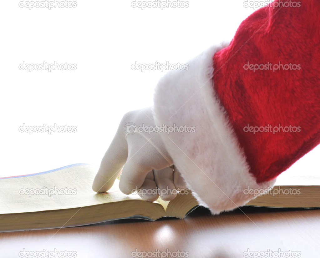 Santa Claus pointing at phone book isolated over white  Stock Photo #2093888