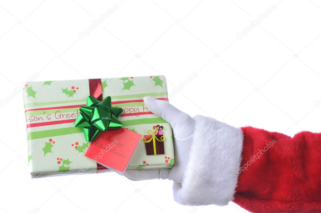 Santa Claus hand holding out Wrapped Christmas Present - isolated on White — Lizenzfreies Foto #2093901