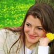 A girl with yellow flowers - Stock Photo