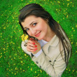A smiling girl with yellow flowers — Stock Photo