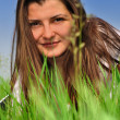 Girl with a fresh green grass — Stock Photo