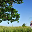 Young woman in a field — Foto Stock