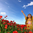 Little girl and field with poppy — Stock fotografie #2078419