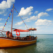 Foto de Stock  : Orange, lonely Boat in Caribbean