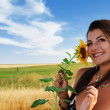 Beautiful girl in a field — Stock Photo
