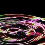Beautiful splash of water purple — Stock Photo