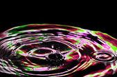 Belo toque de roxo de água — Fotografia Stock