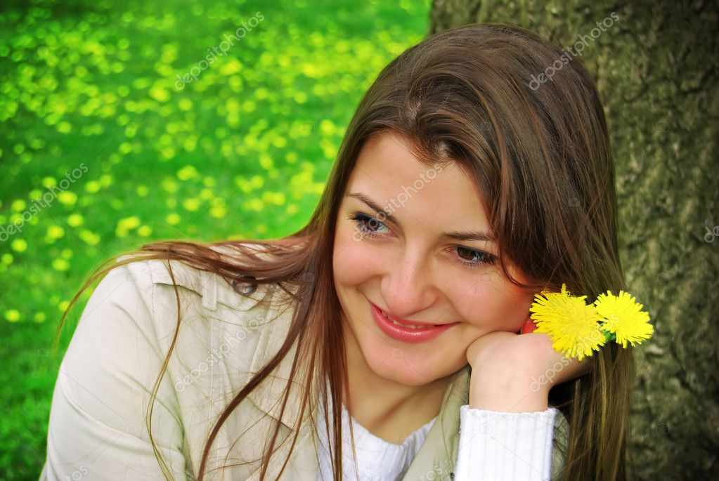 A girl with yellow flowers — Stock Photo #2075499