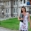Business woman in front of her house 1 - Foto Stock