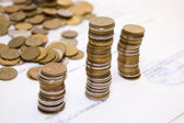 Coins on contract — Stock Photo