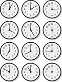 Vector clock faces — Stock Vector
