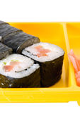 Sushi roll on yellow plate — Stock Photo