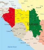 Abstract vector color map of Guinea country colored by national flag — Stock vektor