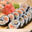 Sushi on wood plate — Stock fotografie