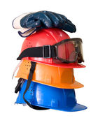 Hardhats, gloves and goggles — Stock Photo