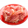 Jamon at red dish — Stock Photo