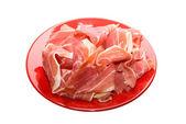 Jamon at red dish — Stock Photo