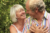 Loving mature couple about to kiss — Stock Photo