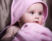 Low key portrat of a five month old baby — Stock Photo