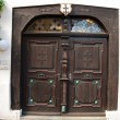 Old wooden door close-up - Stock Photo