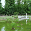 Small pond with statue in Tuileries park — Stock Photo