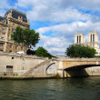 Seine river and Louvre - Stock Photo