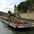 Tourist ship on Seine river in Paris - Stock Photo