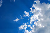 Glowing cloudscape with sunbeams — Stock Photo