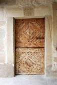 Old wooden fortress door — Stock Photo