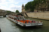 Tourist ship on Seine river in Paris — Stok fotoğraf