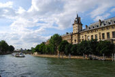 Seine river with tourist ship, embankmen — Stok fotoğraf