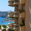Monaco round balcony and blue sea - Stock Photo