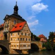 Medieval town hall on the bridge - Stock Photo
