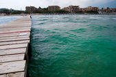 Mediterranean Sea and the wooden pier — Stock Photo