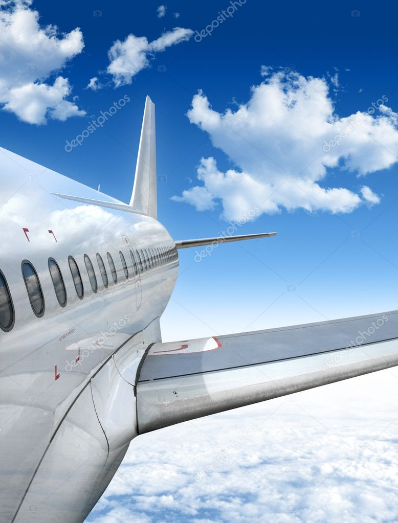 Airplane Flying above the Clouds  Stock Photo #2026292