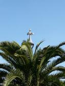 Palm and crucifix — Stock Photo